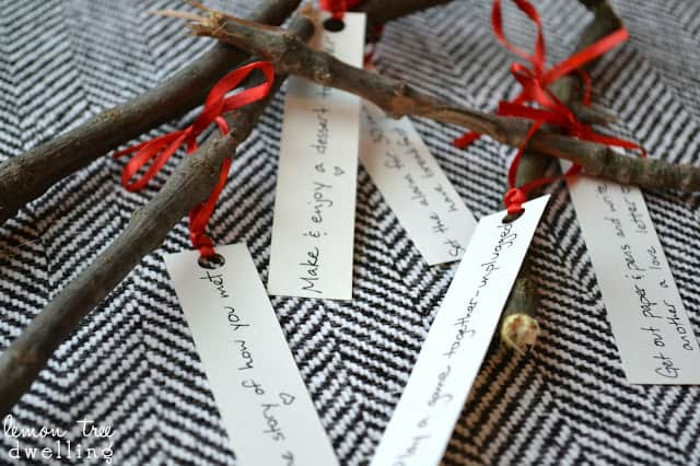 Love Kindling - romantic ideas written out and tied onto twigs