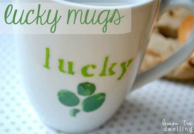 "white coffee mug hand painted with 4 leaf clovers and the words ""Lucky"""