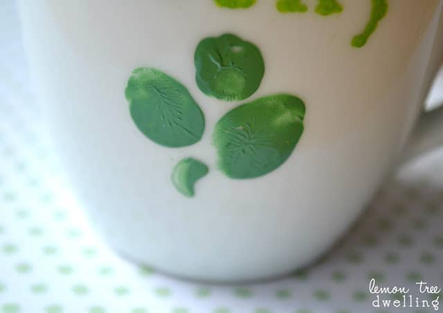 a white coffee cup decorated for St. Patrick's Day