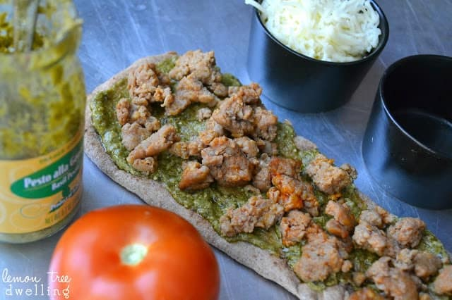 These Pesto Sausage Flatbreads combine traditional basil pesto with sweet Italian sausage to make an easy appetizer that is simply delicious!
