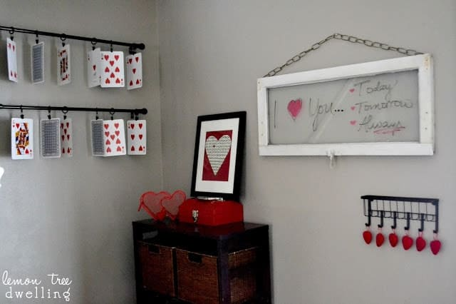 pieces of DIY wall art hang on a living room wall