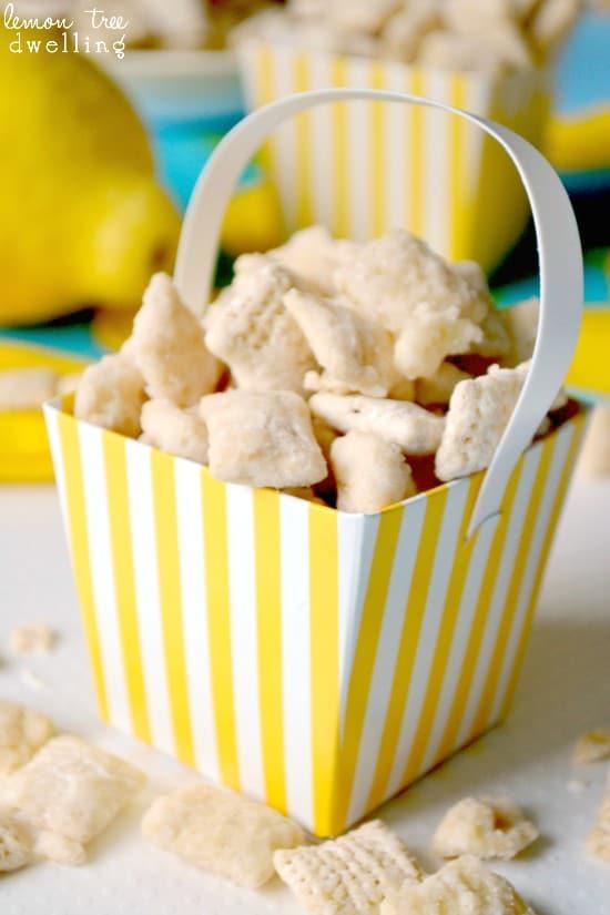 Lemon Bar Muddy Buddies - made with white chocolate & lemon curd. Tastes just like real lemon bars!