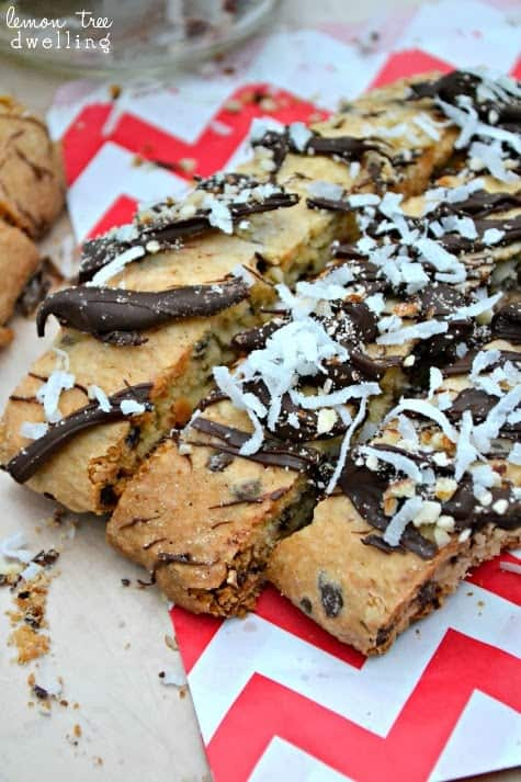 Almond Joy Biscotti is sinfully delicious! This rich biscotti is stuffed with chocolate, coconut, and almonds and drizzled with more of the same!