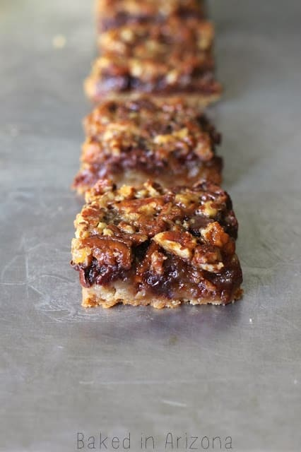 http://www.bakedinaz.com/2013/11/chocolate-pecan-pie-bars.html