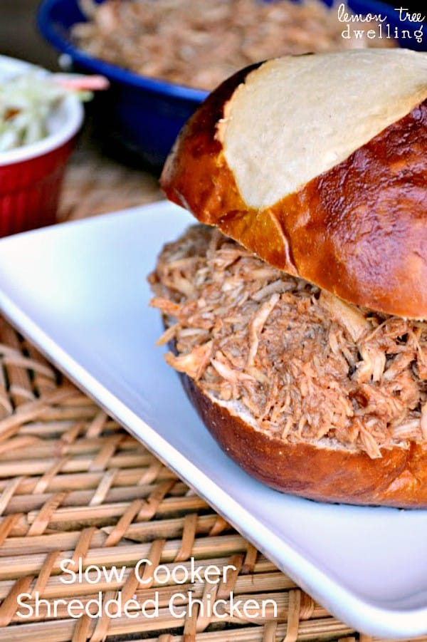 Slow Cooker Shredded Chicken is moist and juicy that it literally shreds itself! This game day sandwich is a must in your house! It is the best I've ever tasted....no barbecue sauce needed!!