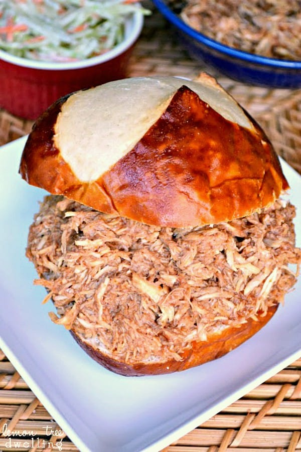 Slow Cooker Shredded Chicken is moist and juicy that it literally shreds itself! This game day sandwich is a must in your house! It is the best shredded chicken I've ever tasted....no barbecue sauce needed!!
