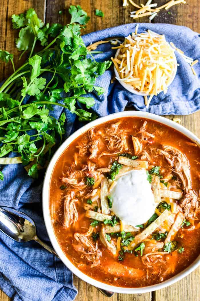 Chicken Tortilla Soup with fresh cilantro and shredded cheese