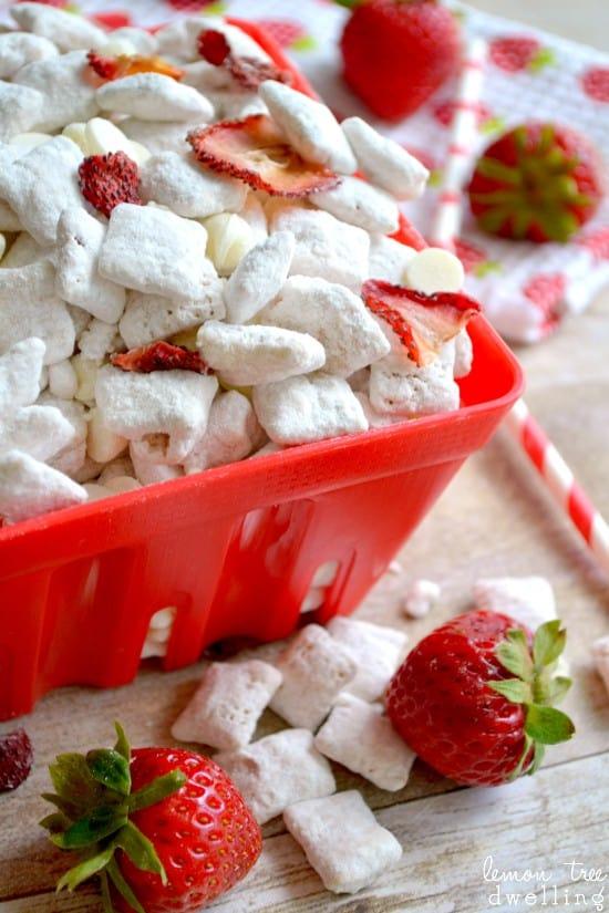 Strawberry Shortcake Muddy Buddies - the sweetness of strawberry shortcake with the crunch of muddy buddies - the perfect summer treat!!