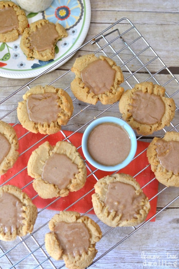 Fresh baked peanut butter cookies topped with a delicious brown sugar maple cinnamon glaze. Perfect for fall!