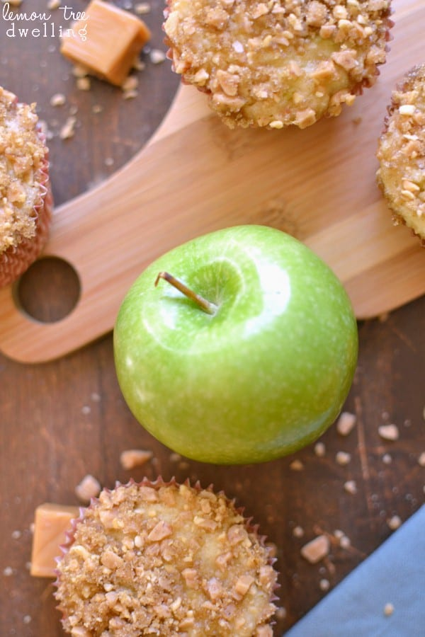 Green apple on cutting board with muffins