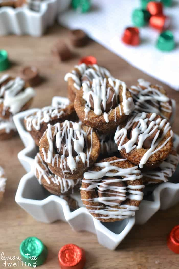 Molasses Rolo Cookie Cups are packed full of holiday flavors! Rolled in sugar, stuffed with Rolos, and drizzled with white chocolate, these cookie cups are a deliciously unexpected combination!