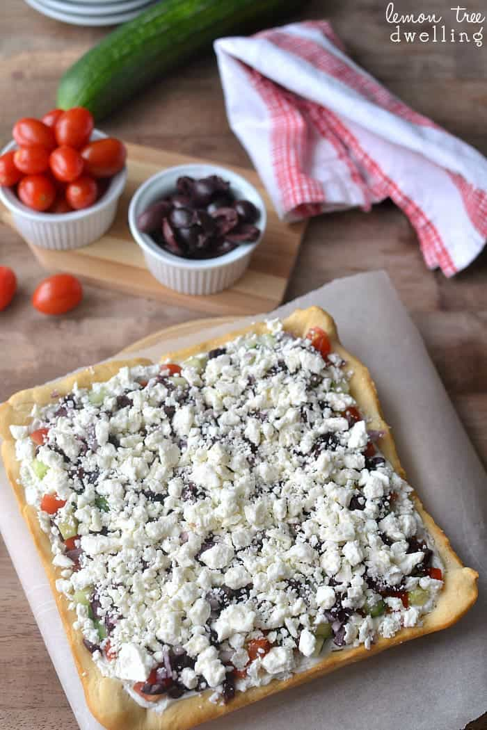 Greek Veggie Pizza with a crescent roll crust. I love this twist on the original!