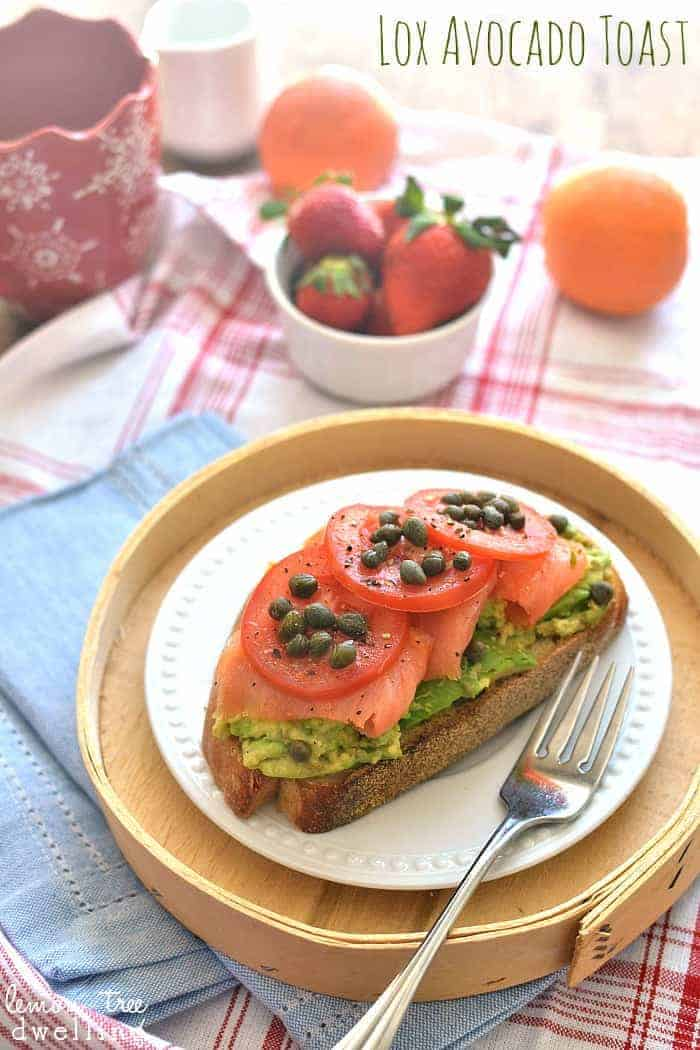 Lox Avocado Toast with tomatoes, capers, and fresh ground salt & pepper - SO yummy!