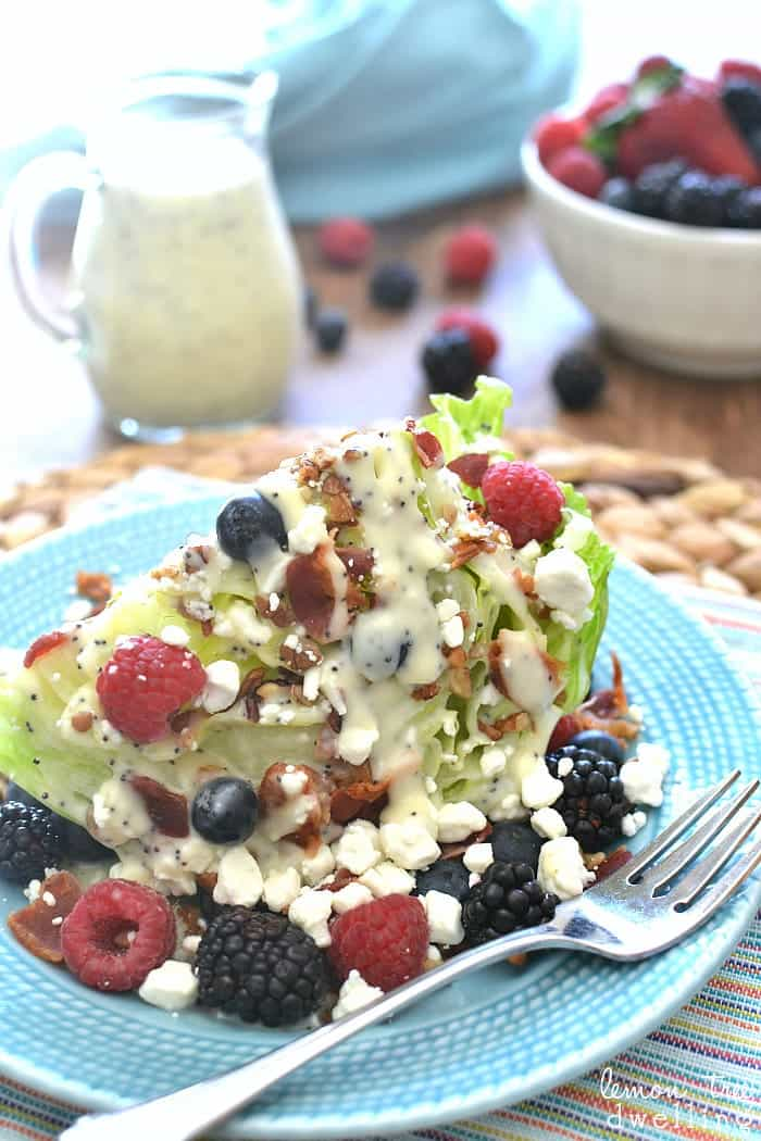 Berry Wedge Salad - 3 kinds of berries, bacon, pecans, goat cheese, and creamy poppy seed dressing