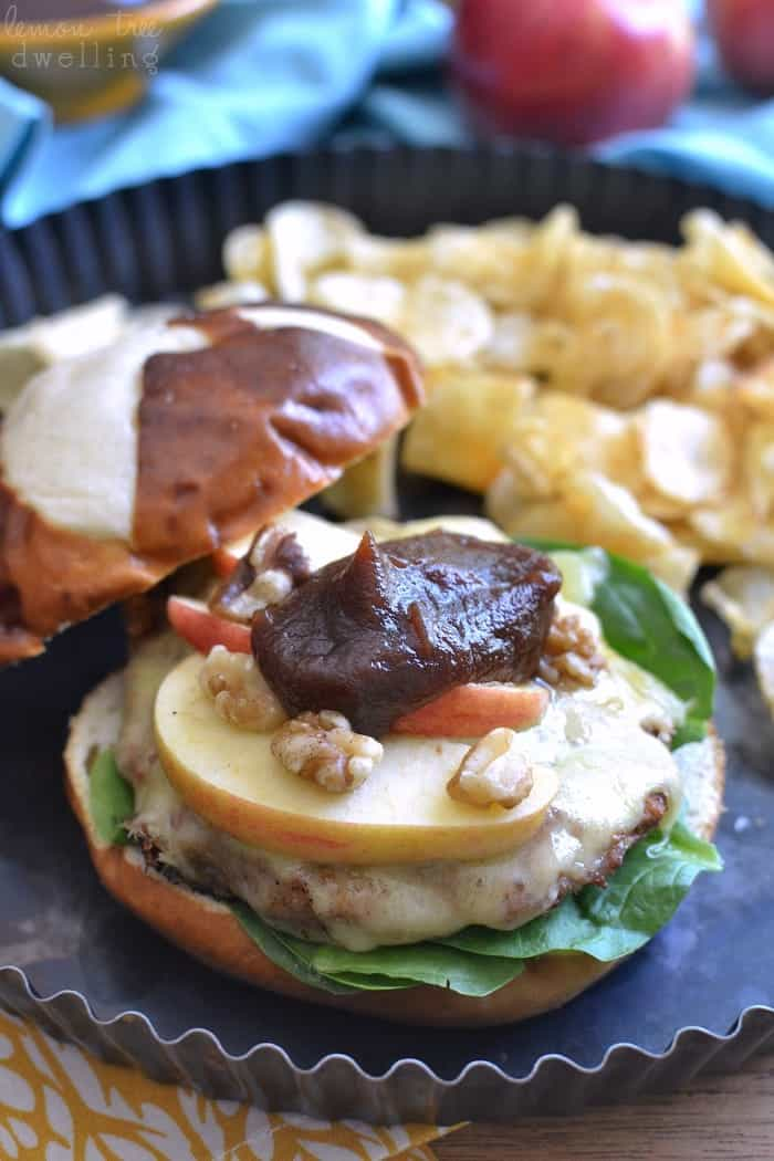 These Cheddar Apple Turkey Burgers are grilled to perfection and topped with aged cheddar, sliced Gala apples, chopped walnuts, fresh spinach, and a healthy dose of apple butter. Perfect for early fall grilling! #kggrassfed