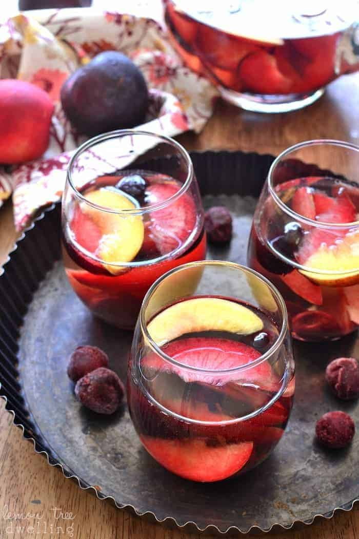 This Plum Sangria is flavored with amaretto and packed with fresh plums, nectarines, and cherries. Deliciously sweet and easy on the eyes....hands down my favorite new sangria!