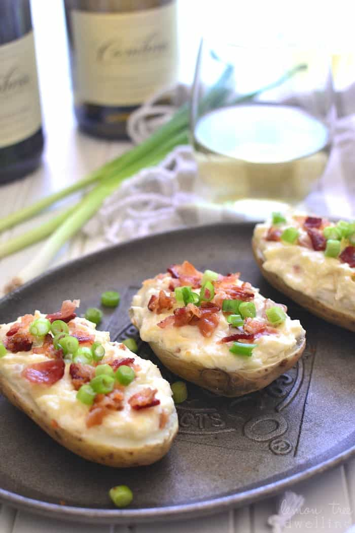 These Cheesy Bacon Potato Skins are loaded with three types of cheese, smoky bacon, and crisp chardonnay. Perfect for game day, ladies' night, or anytime in between!