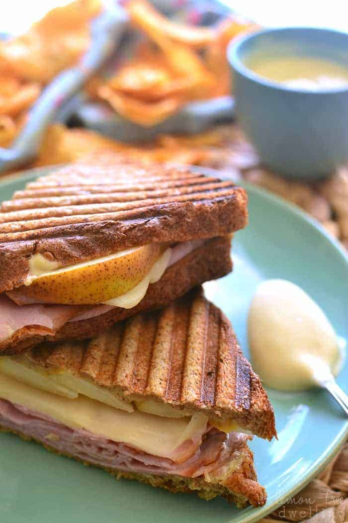 This Ham & Pear Panini is packed with ham, swiss, and fresh pears, then slathered in a delicious maple dijon mayo and grilled to perfection!