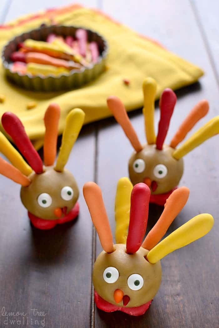 These Thanksgiving Cookie Dough Turkeys are simple, delicious, and SO fun for Thanksgiving! They're perfect for a class party or Thanksgiving dinner, and best of all, the kids can help you make them!