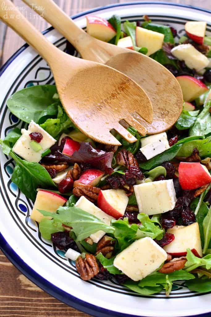 Apple Brie Salad in bowl with serving spoons