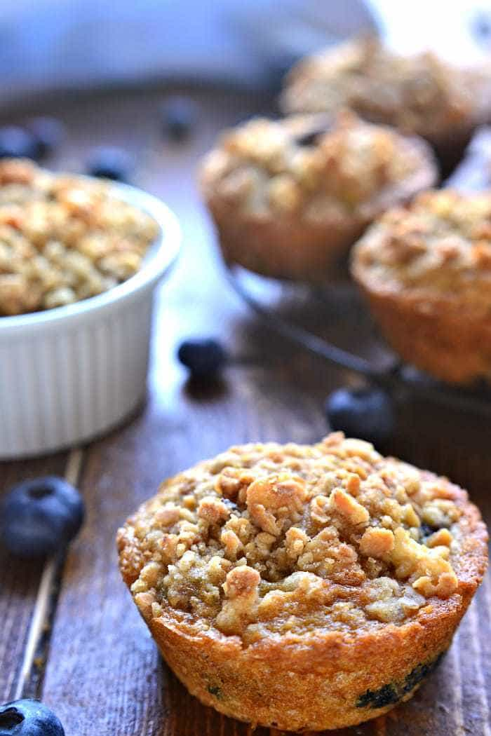 Blueberry Muffins get a makeover with the delicious addition of granola! These Blueberry Granola Muffins are packed with sweet blueberries and vanilla almond granola, then topped with granola streusel for a crunchy finish. Sure to become a family favorite!