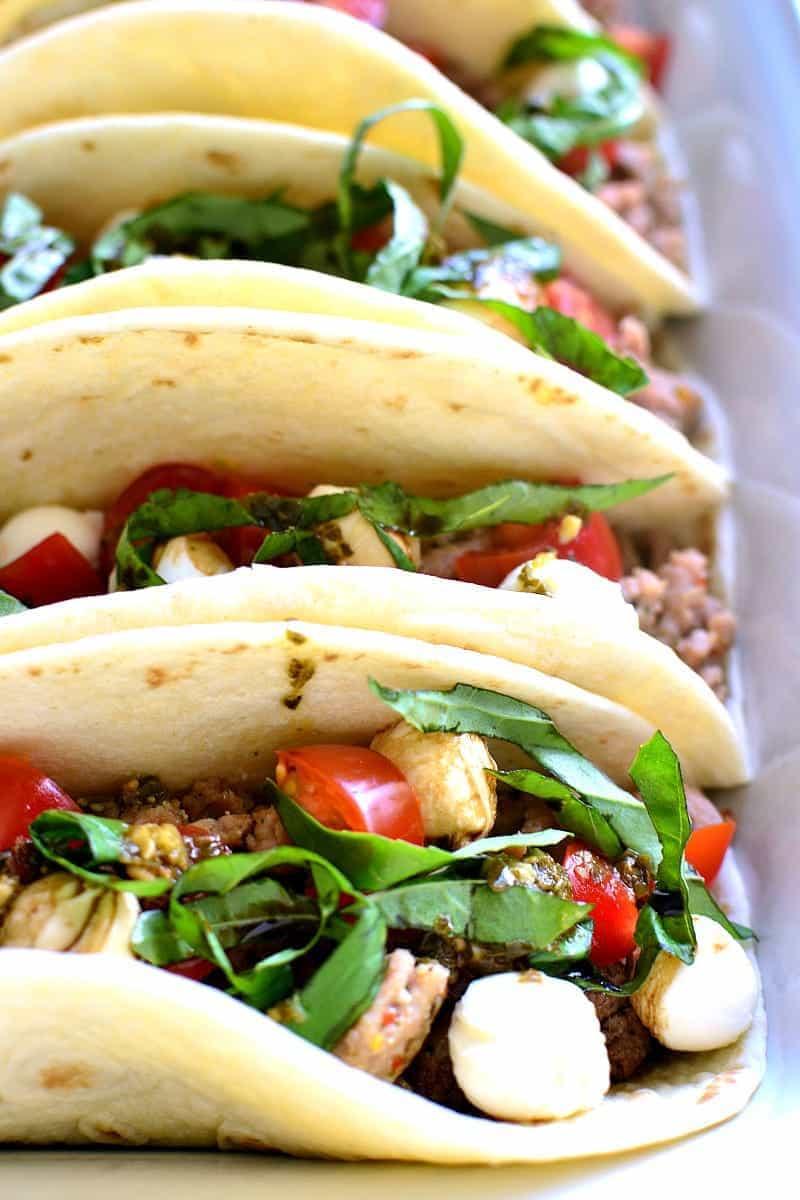 Italian tacos made with fresh basil, tomatoes, and mozzarella cheese