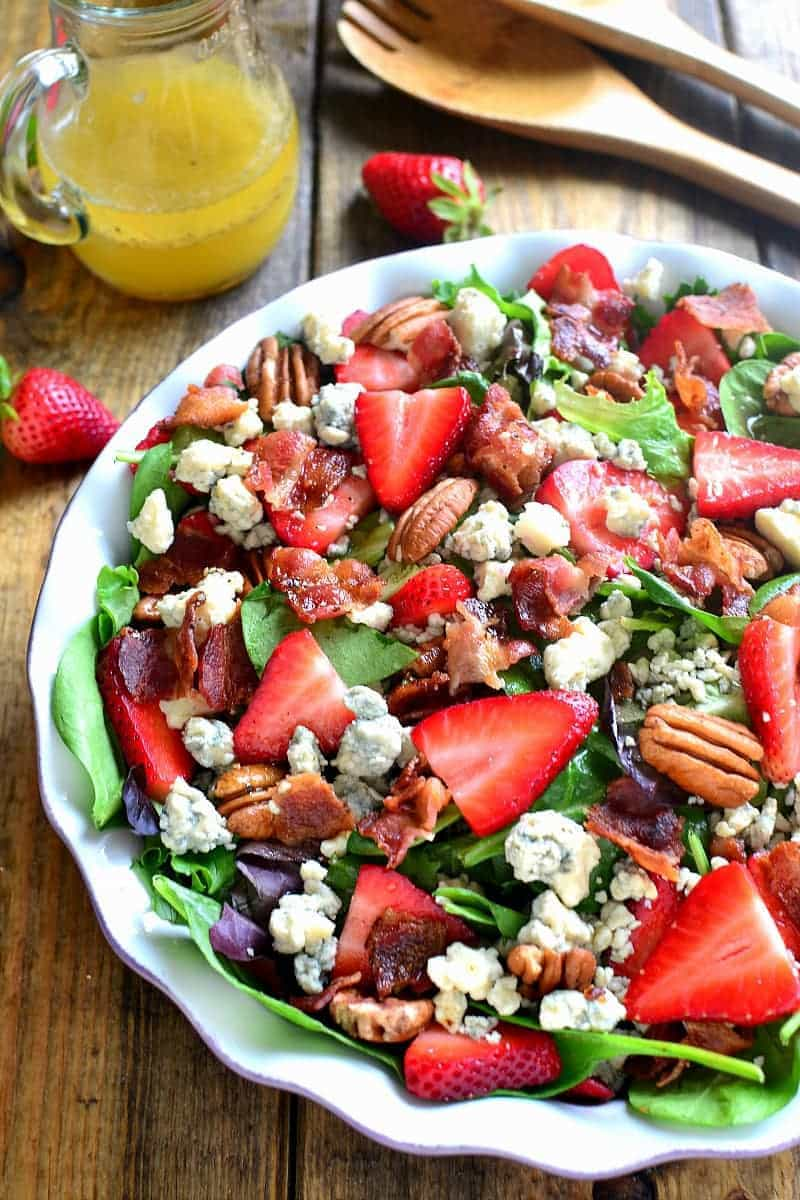 overhead image of a bowl filled with Strawberry Bacon Blue Cheese Crumbles Salad