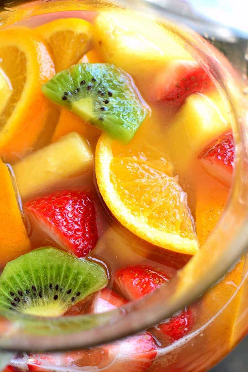 overhead image of a pitcher full of Tropical White Wine Summer Sangria