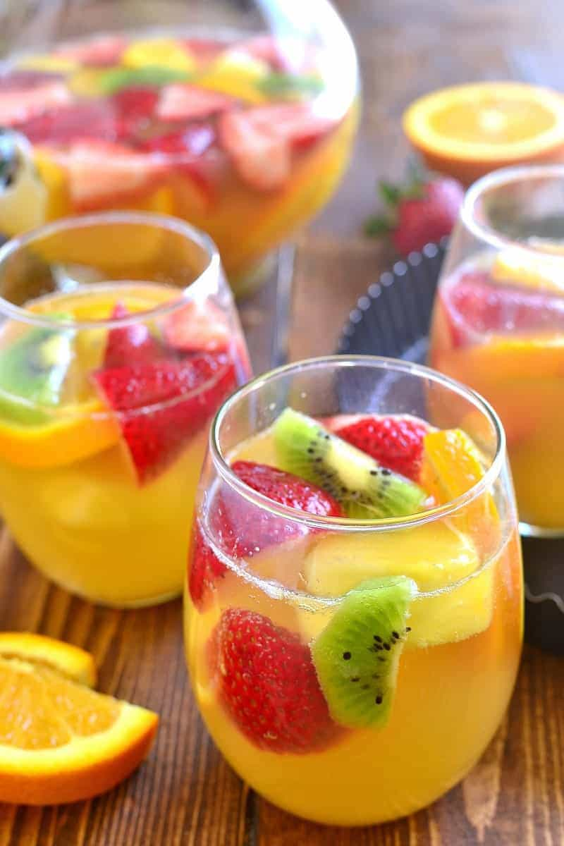 glasses filled with Tropical Fruit White Wine Sangria