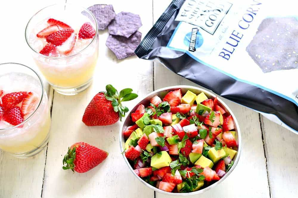 This Strawberry Avocado Salsa is a delicious twist on a favorite! Loaded with fresh strawberries, avocado, jalapeño, and cilantro, it's the perfect summer appetizer!