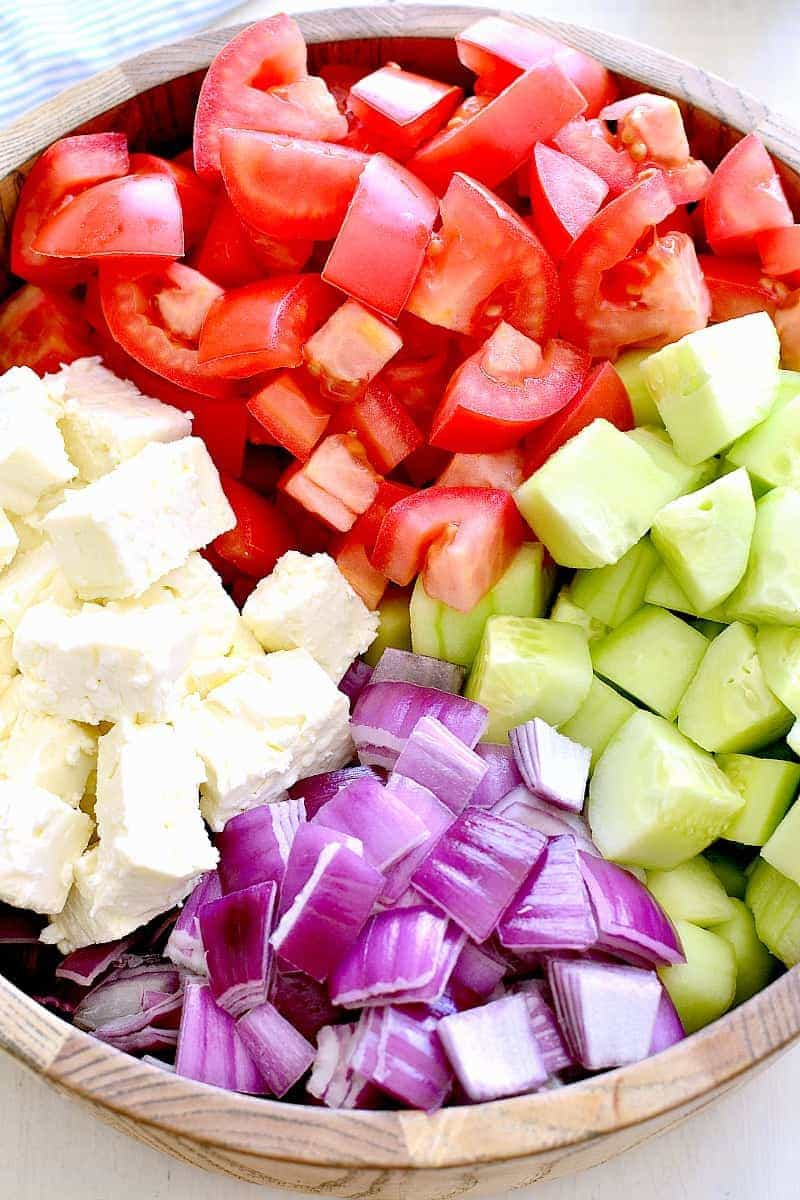 Ingredients for a tomato cucumber feta salad