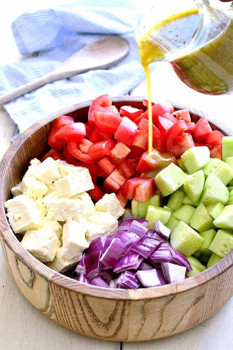 Tomato Cucumber Feta Salad is fresh, flavorful, and SO delicious! This easy summer salad recipe comes together quickly. with just a handful of ingredients. One of our favorite go-to salads for summer!