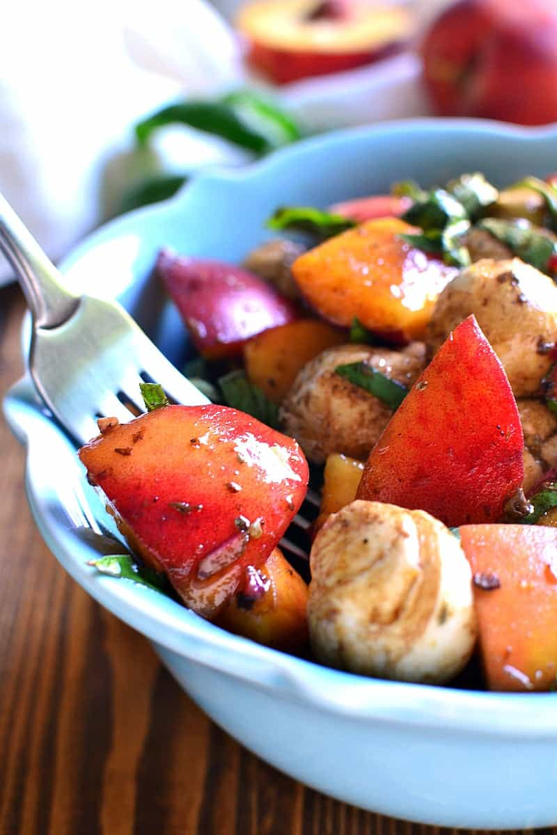 Caprese Peach Salad combines the classic caprese flavors with fresh peaches and homemade balsamic vinaigrette! The perfect end of summer salad!