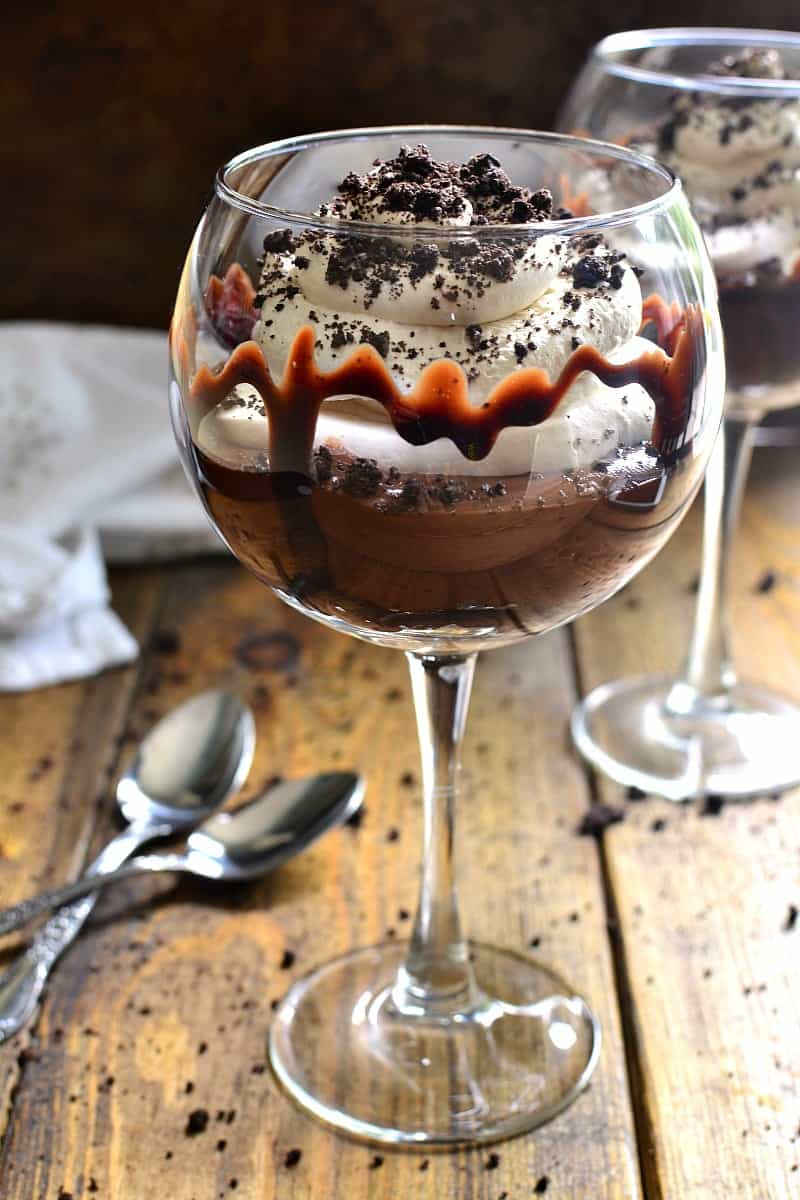 These Mudslide Parfaits have all the flavors of a mudslide cocktail in one decadent dessert! Perfect for date night, ladies night, or a special occasion, these parfaits are SO delicious you'll be licking your glass clean!