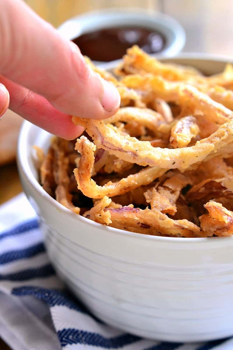 These easy Crispy Onion Strings are the perfect topping for sandwiches, salads, and soups....or delicious all on their own!