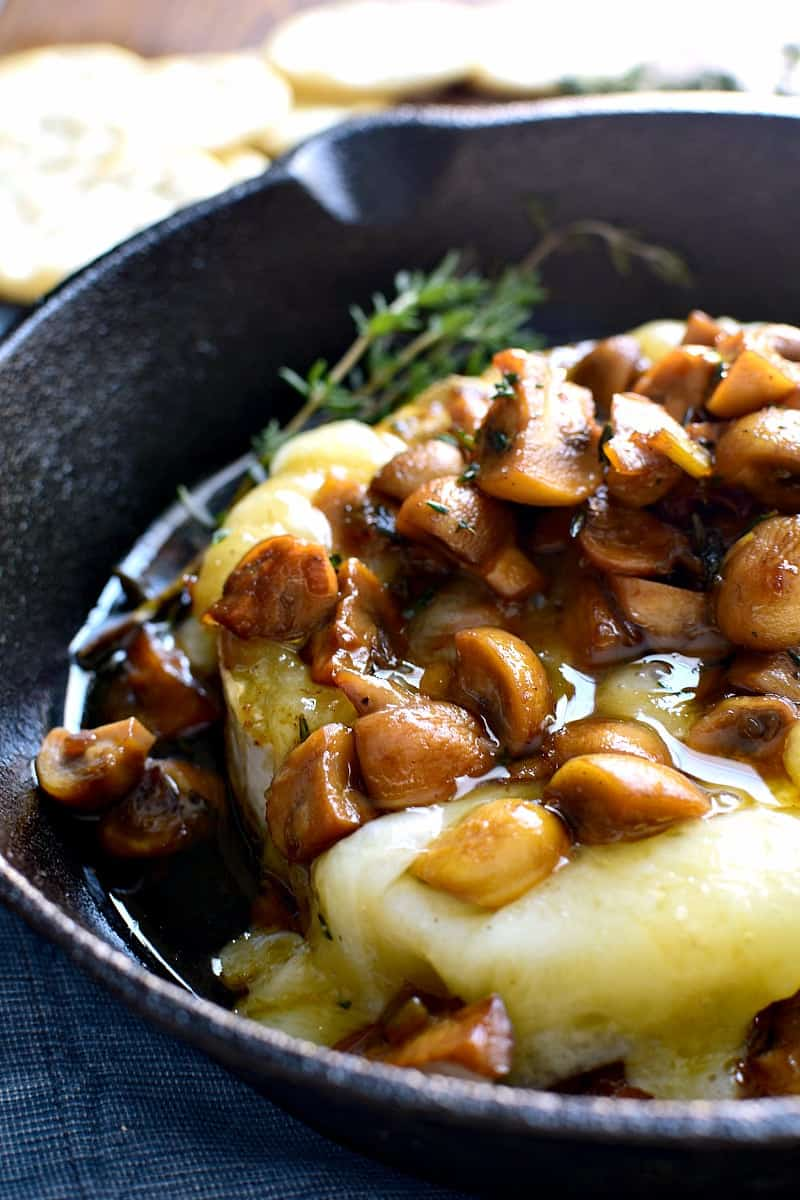 Mushroom Marsala Baked Brie combines rich marsala-glazed mushrooms with creamy baked brie in a delicious appetizer that's perfect for New Years Eve or anytime!