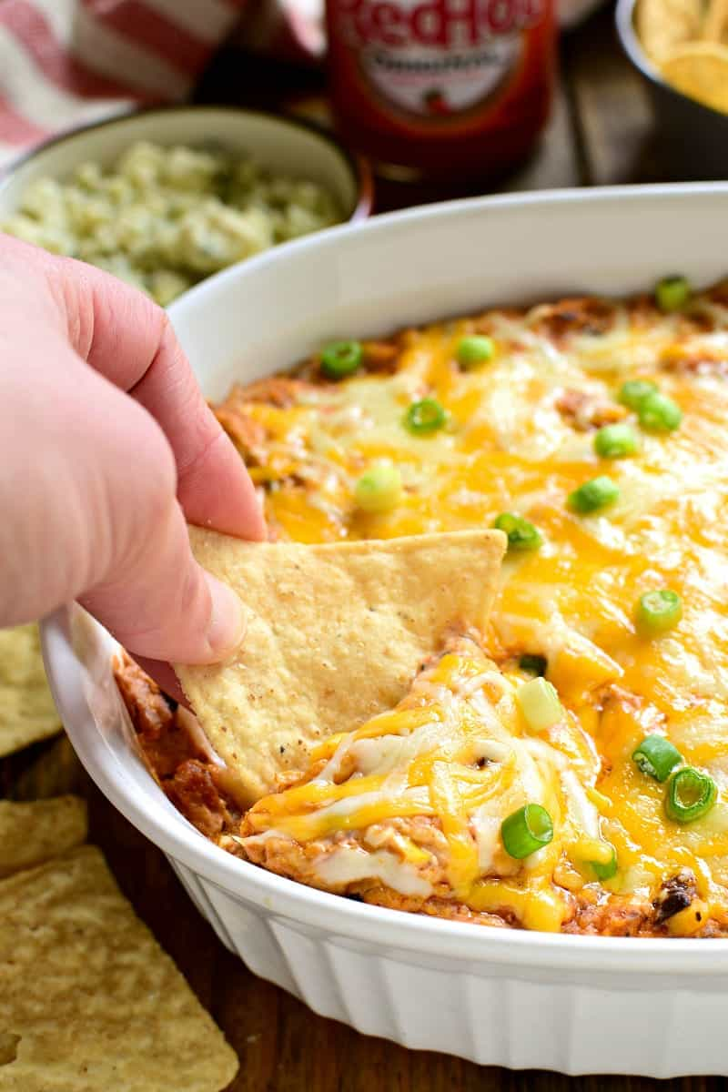 This Southwest Buffalo Chicken Dip puts a southwest spin on a party favorite! It's gooey, cheesy, and loaded with delicious flavor....perfect for game day!