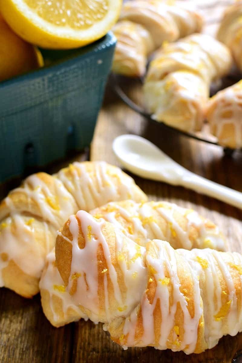 These Lemon Cheesecake Crescent Rolls are bursting with bright lemon flavor! Flaky crescent rolls filled with creamy lemon cheesecake and topped with a citrus glaze....they're the perfect addition to any brunch!