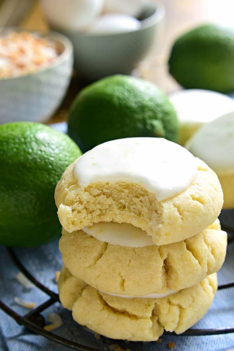 These Coconut Lime Sugar Cookies are a delicious taste of the tropics! Soft, pillowy sugar cookies flavored with coconut and lime zest, then topped with a sweet lime icing. Sure to become a new favorite!