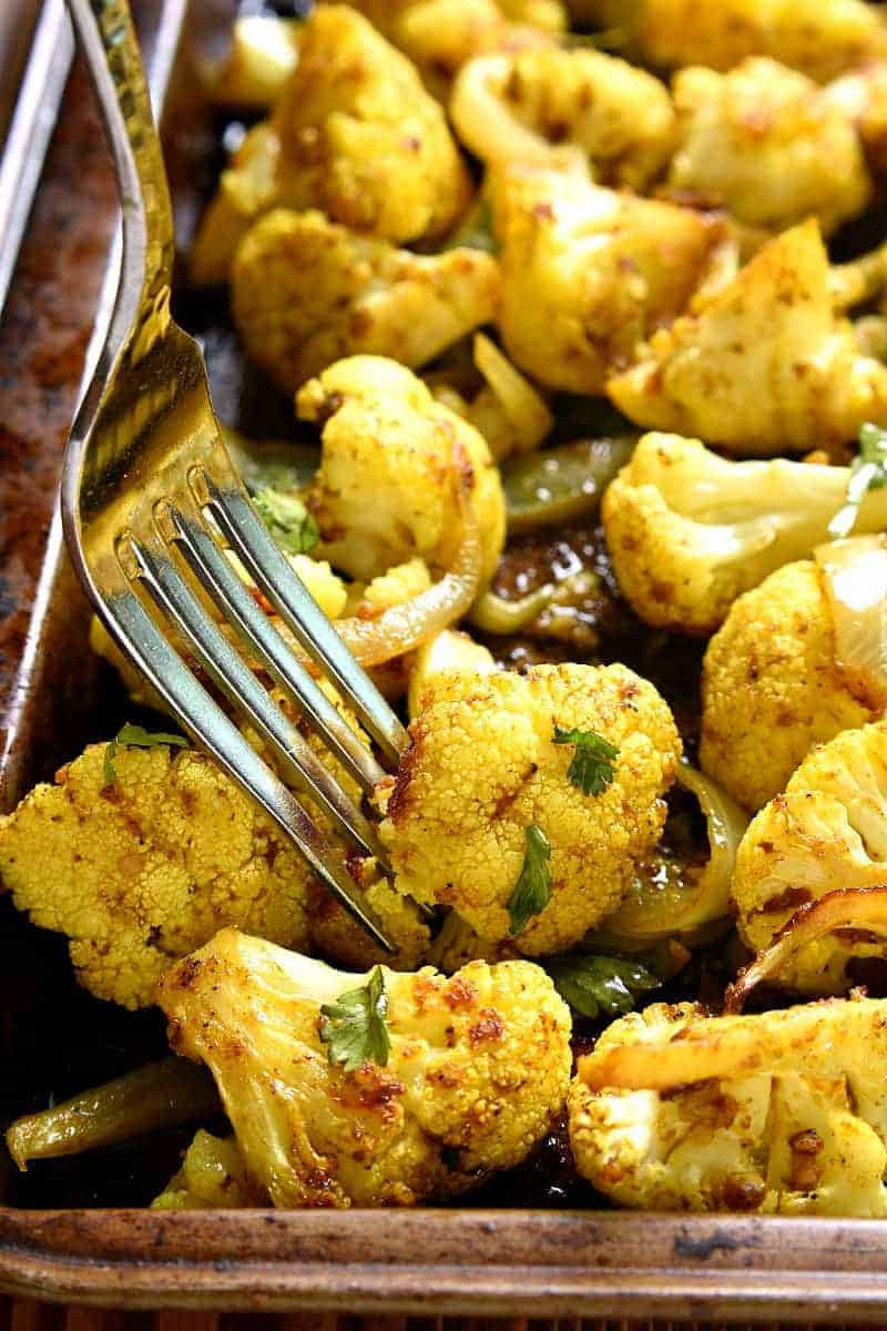 curry flavored roasted cauliflower on a sheet pan