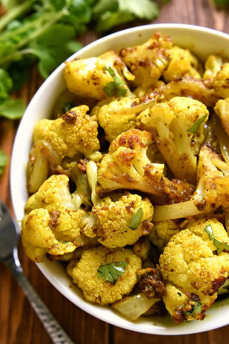 overhead image of a bowl filled with curry roasted cauliflower