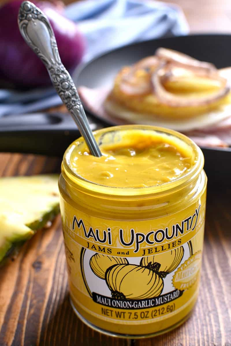 jar of Maui onion-garlic yellow mustard with a spoon in the jar