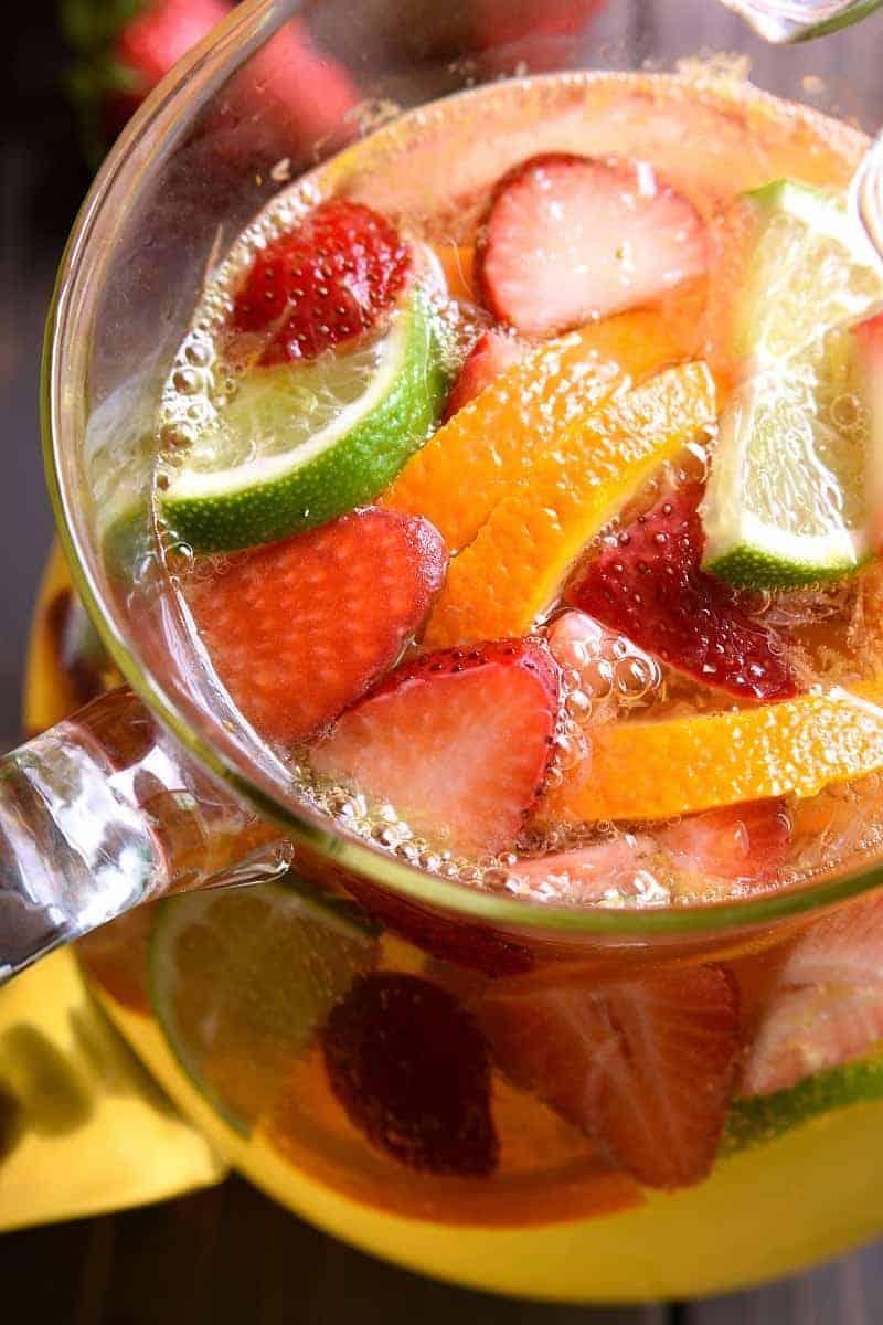 A pitcher of Sparkling Skinny Sangria full of fresh fruit slices