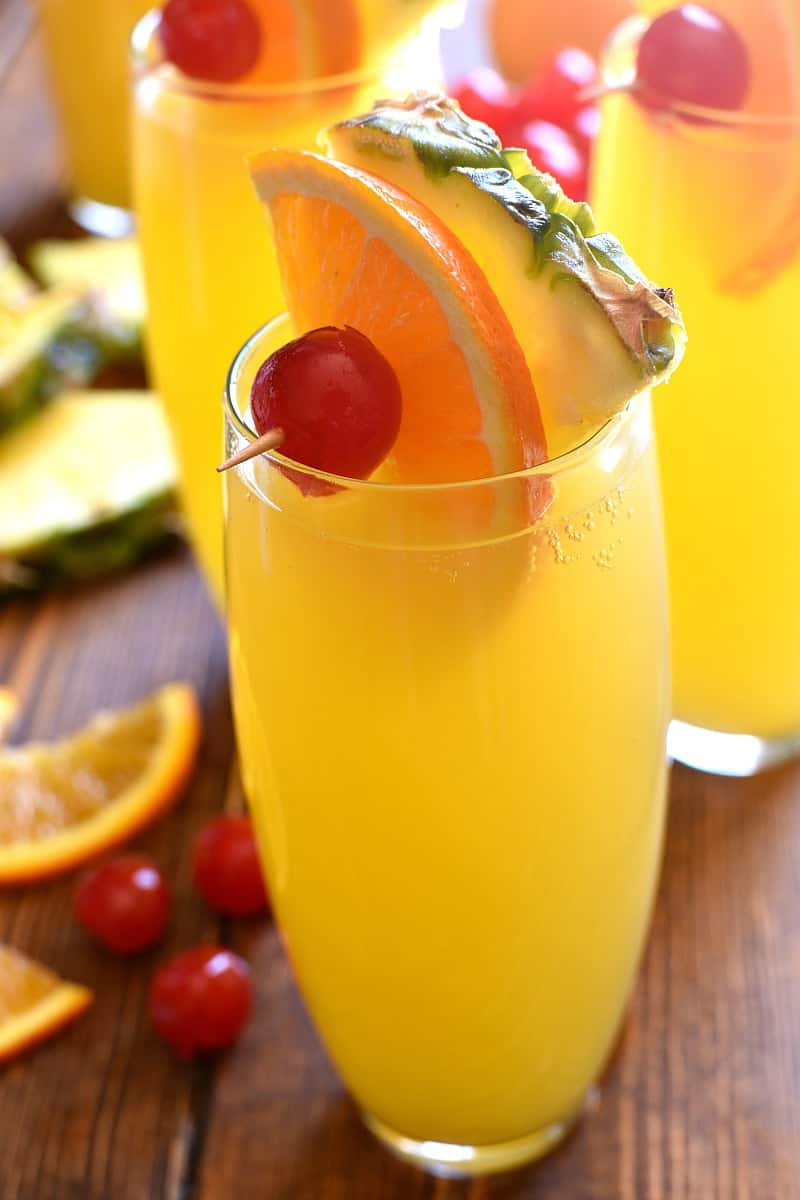 tall glasses filled with Tropical Mimosas