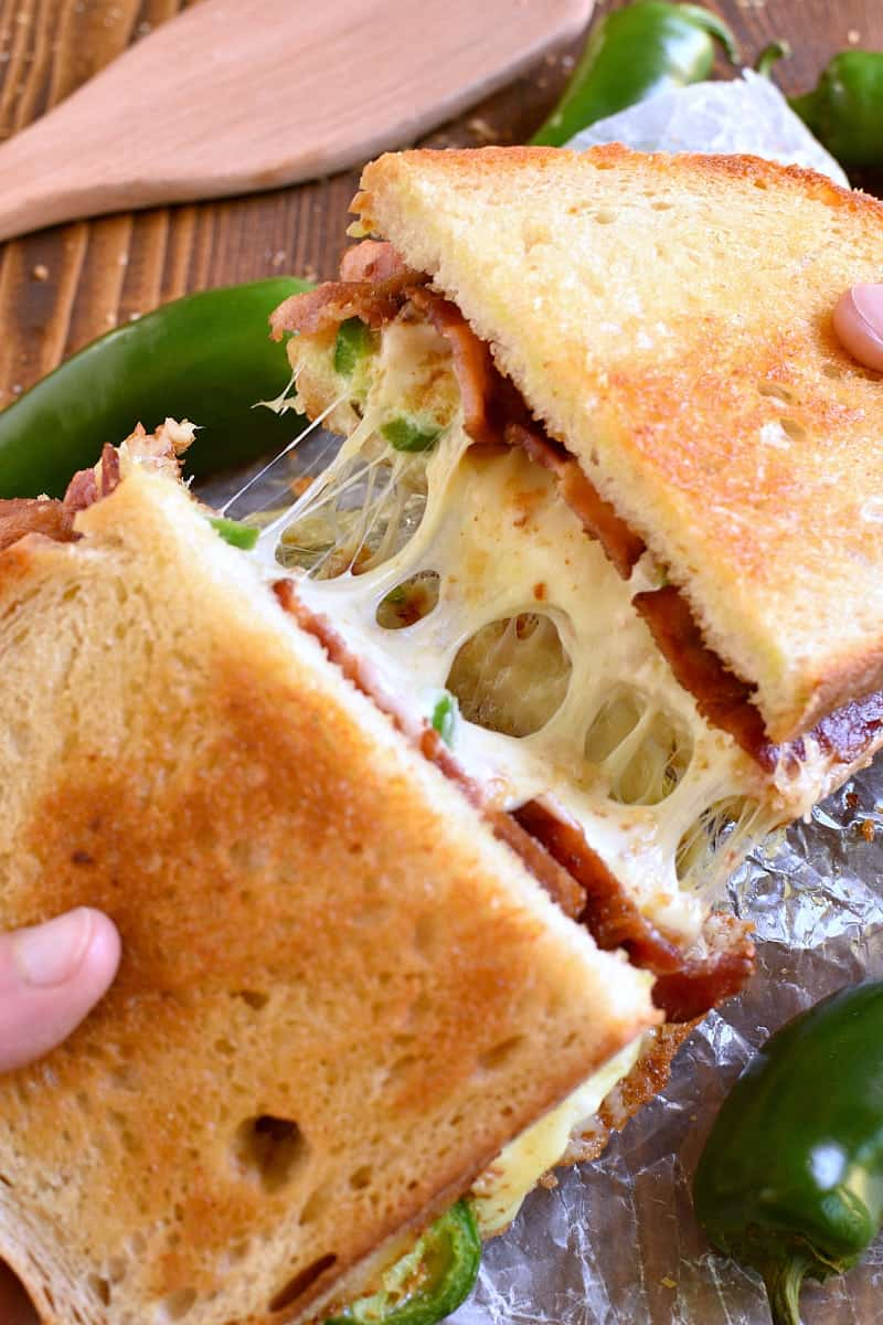 This Jalapeño Popper Grilled Cheese is EVERYTHING!! Gooey, spicy, cheesy, and SO delicious. If you love jalapeño poppers you'll go crazy for this awesome sandwich!