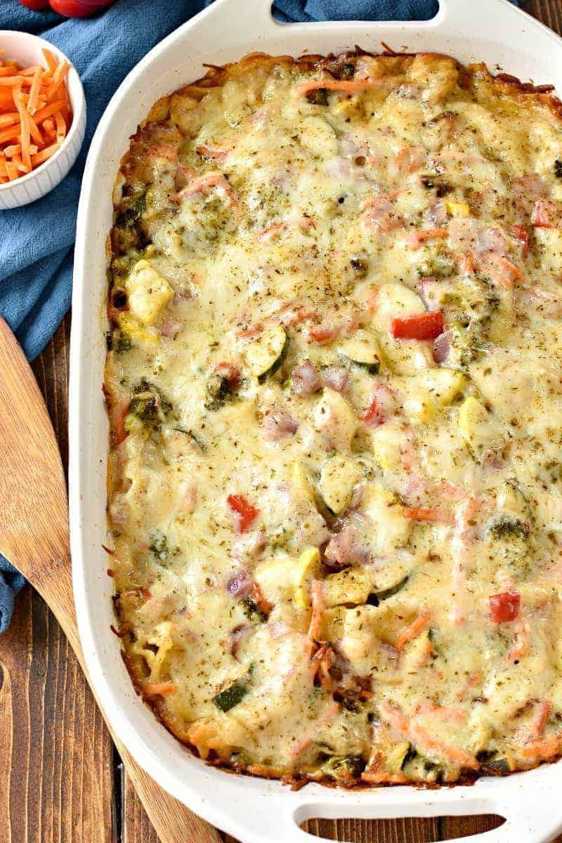 This Creamy Vegetable Lasagna is loaded with fresh summer veggies, 3 types of cheese, and the most delicious cream sauce! A delicious alternative to traditional lasagna....and perfect for summer!