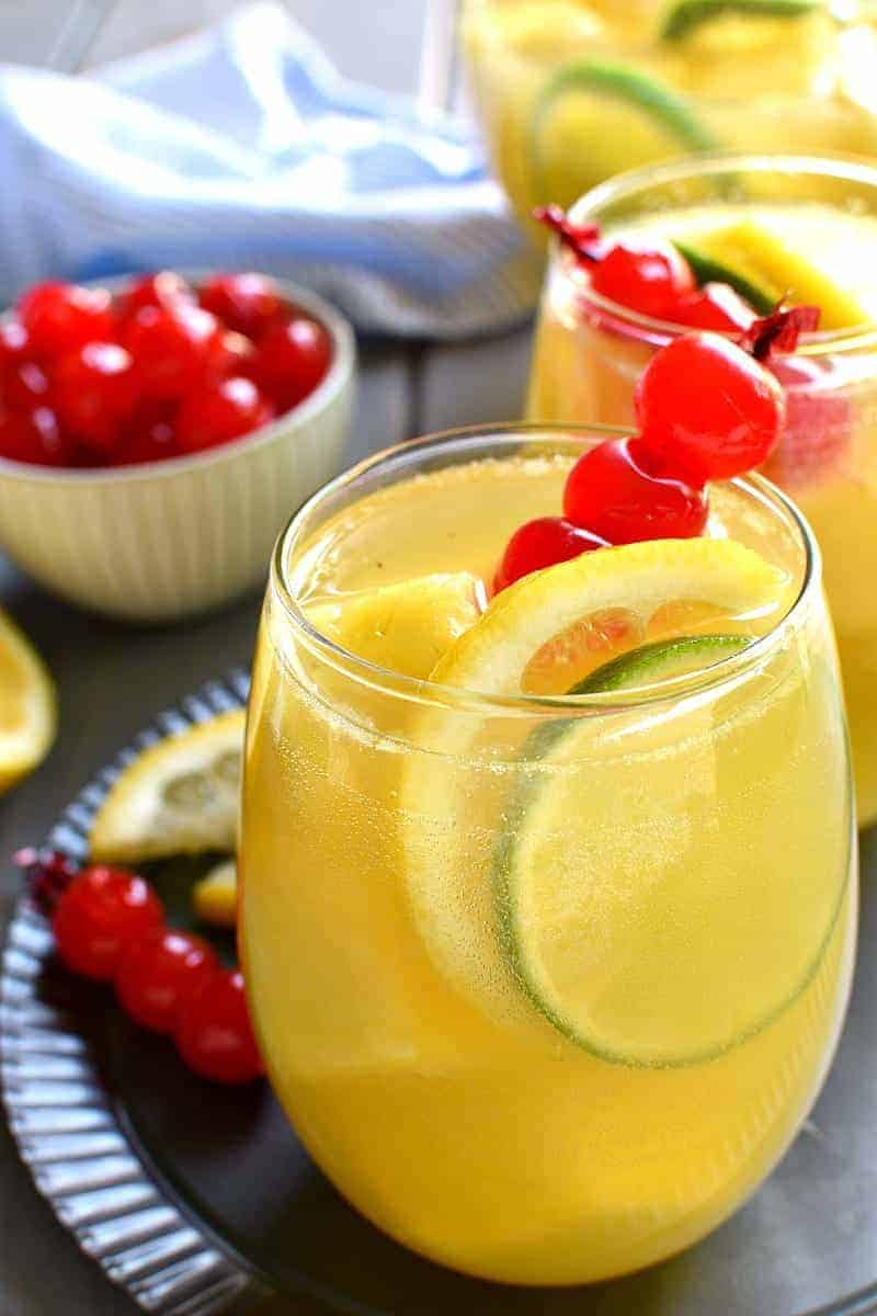 If you love pineapple, this Pineapple Sangria is for you! Made with prosecco, pineapple juice, and white rum, this sangria is sweet, refreshing, and perfect for summer parties!
