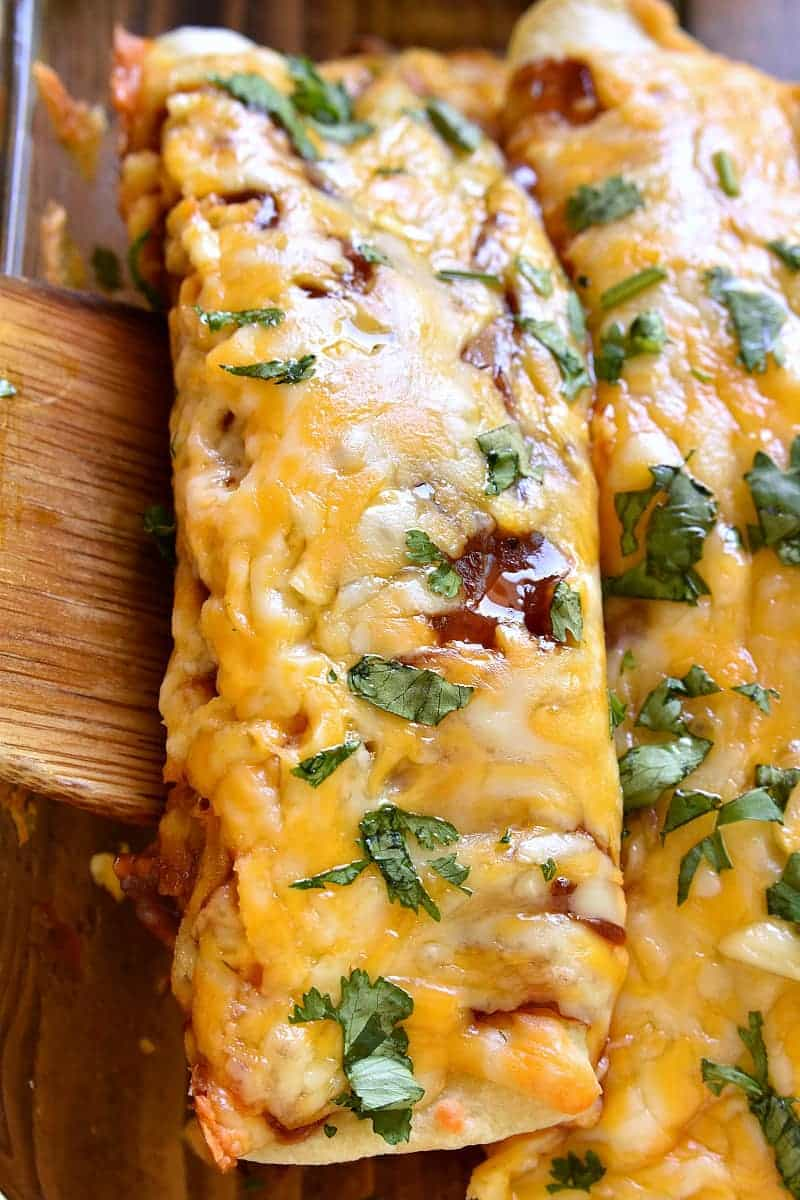 These BBQ Chicken Enchiladas are EVERYTHING!! Loaded with rotisserie chicken, bacon, barbecue sauce, and gooey cheese, they're packed with delicious flavor and sure to become a new family favorite!