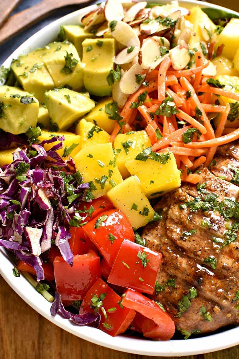 This Caribbean Grilled Chicken Salad combines all the best flavors of the Caribbean in one delicious dish! Loaded with pineapple, mango, avocado, red pepper, and homemade honey lime vinaigrette, this salad is sure to satisfy all your tropical cravings!