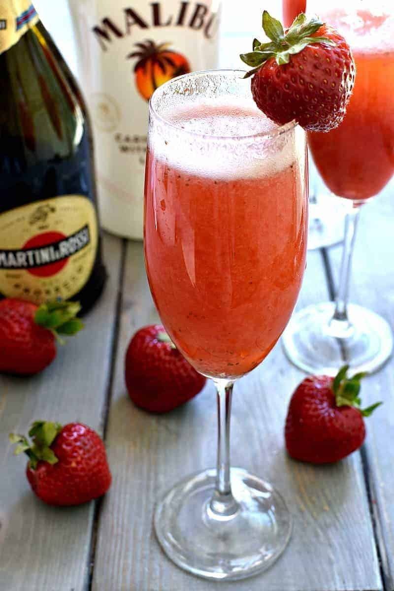 This Strawberry Coconut Bellini is a deliciously sweet, refreshing, tropical twist on the original! Made with just three ingredients, it's the perfect cocktail for brunch, ladies night, or any night! And you won't believe how easy it is to make!